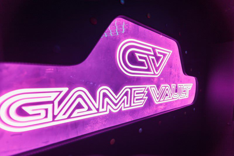 Game Vault neon logo from inside