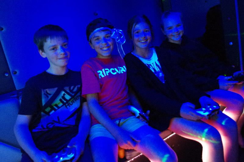 Game Vault - Kids posing and smiling while waiting for their game to start